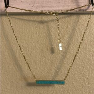 Gold-toned turquoise bar necklace.